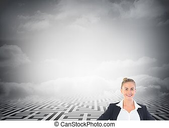 Blonde businesswoman standing with hands on hips - Composite...