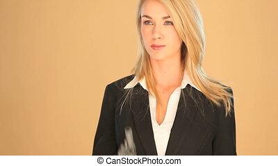 Blonde businesswoman with a gun