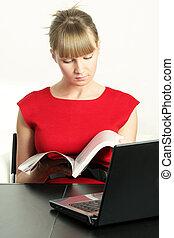 Blonde businesswoman with magazine
