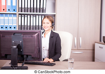 Blonde call center operator talking in the headset