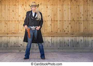 Blonde Cowgirl - A blonde model posing as a cowgirl in a...