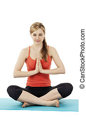 blonde cute fitness woman exercising yoga on a mat on white background