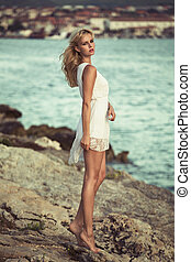 Blonde delicate girl on the rocks - Blonde delicate woman on...