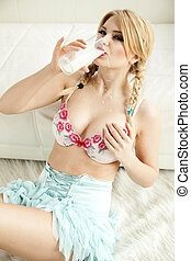 blonde drinking milk