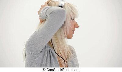 Blonde enjoying music