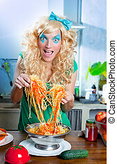 Blonde fashion funny on kitchen with pasta and