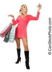 Blonde fashion model at shopping