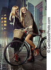 Blonde friends enjoying spare time in the downtown