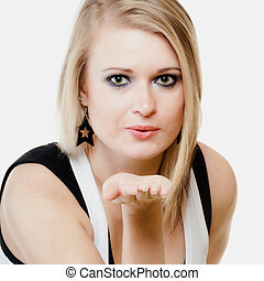 Blonde girl blowing a kiss or with copy space on hand