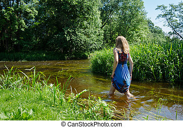 blonde girl blue mottled dress wade flowing river - blonde...