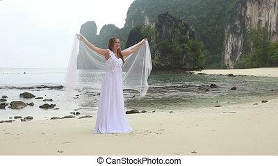 blonde girl demonstrates her wedding dress