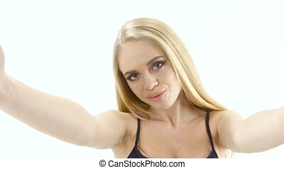 Blonde girl doing different poses and emotions on camera. Studio