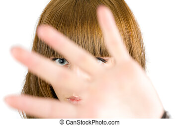 Blonde girl hiding behind her palm, isolated on white...