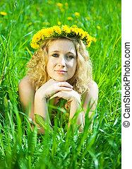 Blonde girl in dandelion wreath