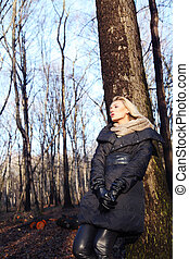 Blonde girl in forest.