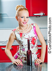 blonde girl in kitchen interior