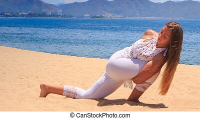 blonde girl in lace shows yoga asana hands lock round leg