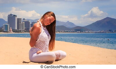 blonde girl in lace shows yoga asana lotus