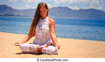 blonde girl in lace shows yoga asana lotus left hand up