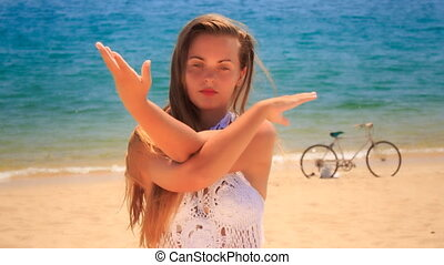 blonde girl in lace shows yoga asana raises interlaces hands