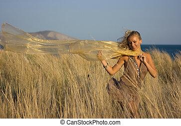 Blonde girl in the field