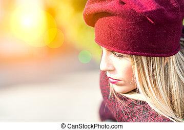Blonde girl in the sunlight