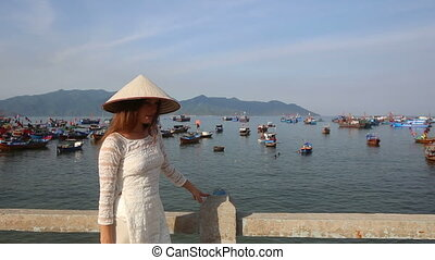 blonde girl in vietnamese has nice time in fishing village