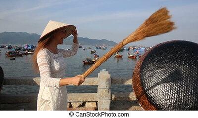 blonde girl in vietnamese has nice time in fishing village