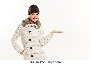 Blonde Girl In Winter Clothes, With Outstretched Palm
