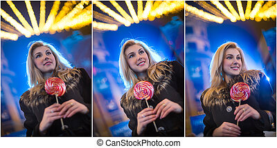 Blonde girl in winter with lollipop