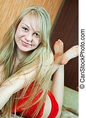 Blonde girl on sofa