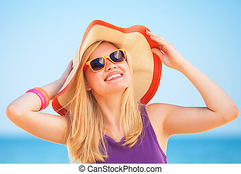 Blonde girl on the beach in spring time.