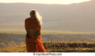 blonde girl on the windy hill