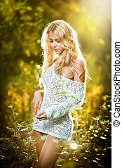 Blonde girl outdoor in sunny day