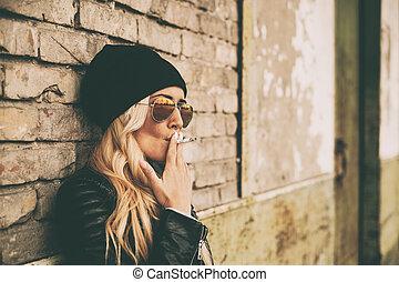 Blonde girl outdoor portrait
