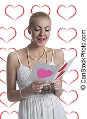 blonde girl reads valentine postcard
