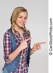 Blonde girl shows her fingers to the side
