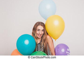 blonde girl smiling and looking at camera between ...