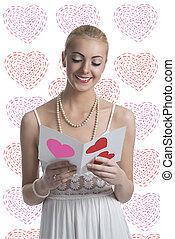 blonde girl takes a valentine postcard