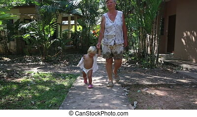 blonde girl toddler directs her grandmother
