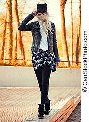 Blonde girl walking on the street