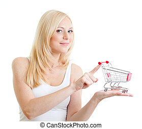 Blonde girl weared in white tank top with small shopping cart in hands isolated