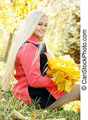 blonde girl with a bouquet of leaves