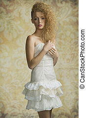 Blonde girl with artistic hairstyle