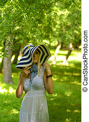 blonde girl with big summer hat