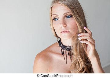 blonde girl with blue eyes portrait fashion