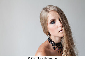 blonde girl with blue eyes portrait fashion