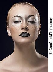 blonde girl with dark lipstick looks down