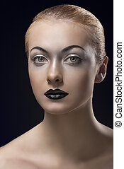 blonde girl with dark lipstick looks in to the lens