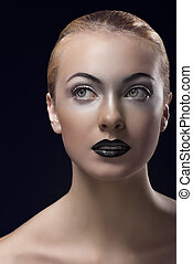blonde girl with dark lipstick looks up at right